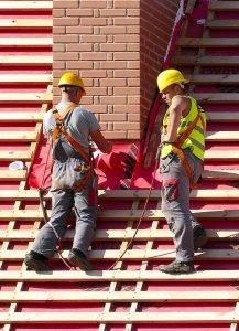 two men performing roof repair